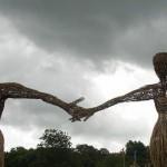 Wicker man & woman under brooding skies.