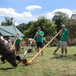 Wind Power Alphorns entertaining a glastonbury cow