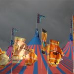 Flags, Acoustic Tent and threatening sky