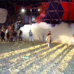 Early morning ravers in the Bassline Circus smoke