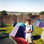 I had a ticket that year (one of the few) and I couldn't find any space to camp on site because too many people had busted in. I was not happy. haha. Not me in the pic, a mate. That is the outside of the fence in the background. We found mates and ended up camping in the NME Stage field. Bit better than where we were in this pic. Amazing weekend!