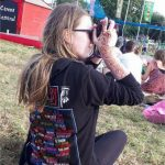 Daughter taking a photo of the trapeze